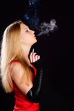 Woman smoking sigarette. Stock Photo