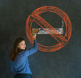 No smoking tobacco woman on blackboard background. No smoking tobacco addict business woman, student or teacher on blackboard background Royalty Free Stock Photos