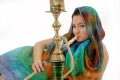 Woman smoking water pipe Stock Image