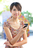 Woman sms on cell phone Royalty Free Stock Photography