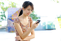 Woman sms on mobile phone Royalty Free Stock Photos