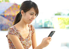 Woman sms on phone Royalty Free Stock Photography