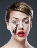 Woman with snail on face Royalty Free Stock Photo