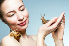 Woman with snails Stock Photo