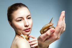 Woman with snails Stock Photography