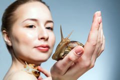 Woman with snails Royalty Free Stock Images