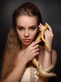 Woman with snake Stock Photography