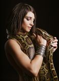 Woman with a snake Royalty Free Stock Photos
