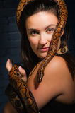 Woman and snake Royalty Free Stock Image