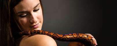 Woman and snake Royalty Free Stock Photography