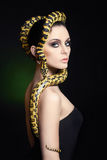 Woman with Snake on her head like a hair Royalty Free Stock Image