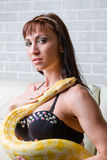 Woman with a snake holding red apple Royalty Free Stock Image