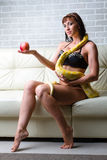 Woman with a snake holding red apple Royalty Free Stock Photography