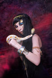 Woman with snake. Portrait of egyptian woman posing with white snake Royalty Free Stock Images