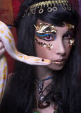 Woman with snake. Portrait of egyptian woman posing with white snake Royalty Free Stock Photography