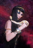 Woman with snake. Portrait of egyptian woman posing with white snake Royalty Free Stock Image