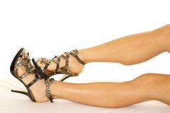 Woman snake skin heels legs out Stock Photos