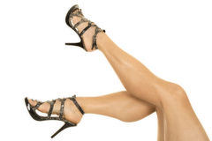 Woman in snake skin heels legs up and out Royalty Free Stock Image