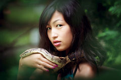 Woman with snake Royalty Free Stock Photography