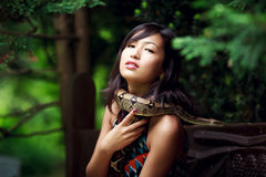 Woman with snake Stock Photo