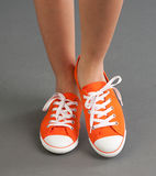 Woman sneakers. A comfortable woman sport shoes or sneakers in orange color Stock Photography