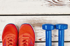 Woman sneakers and dumbbells. Women`s sneakers and dumbbells. Time to get healthier Stock Images