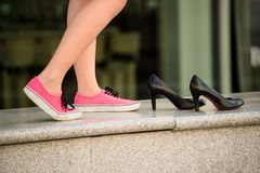 Woman in sneakers Stock Images