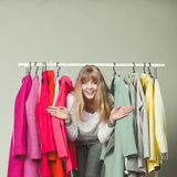 Woman sneaking among clothes in mall or wardrobe. Royalty Free Stock Photo