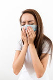 Woman sneeze. With face mask  at home Royalty Free Stock Photography