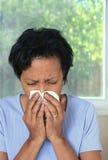 Woman sneezes Royalty Free Stock Photo