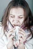 Woman sneezes Stock Images