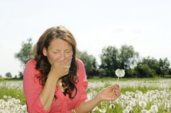 Woman sneezes on a flower meadow Royalty Free Stock Photo