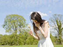 Woman sneezes on meadow Royalty Free Stock Photography