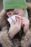 Woman sneezing Stock Photos