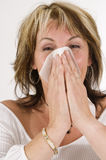 Woman is sneezing Stock Photo