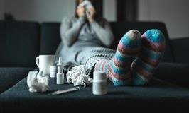 Free Woman Sneezing And Blowing Nose With Tissue And Handkerchief. Sick And Ill Person With Flu, Cold Medicine And Woolen Socks. Stock Image - 137657791