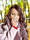 Woman sneezing handkerchief outdoor. Royalty Free Stock Photo