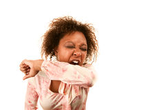 Woman sneezing into her sleeve to prevent disease Royalty Free Stock Images
