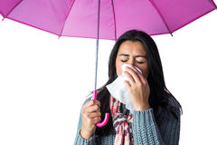Woman sneezing into her tissue Stock Images