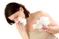 Woman sneezing Stock Image