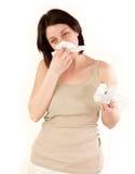 Woman sneezing Royalty Free Stock Image