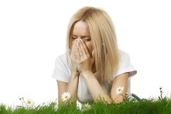Woman sneezing of spring allergy Royalty Free Stock Images
