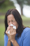 Woman sneezing tissue with flu or hayfever Royalty Free Stock Images