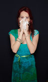 Woman sneezing in tissue sweating from flu fever Stock Photos