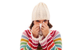 Woman sneezing to a tissue Royalty Free Stock Images