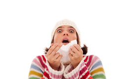 Woman sneezing to a tissue Royalty Free Stock Photo