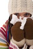 Woman sneezing to a tissue Stock Photo