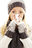 Woman Sneezing. Winter style Stock Image