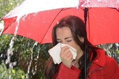 Woman sneezing Stock Photography