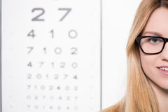 Woman and snellen chart Stock Photo
